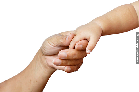 Old female hand holding young baby hand / Love and relationship in a family
