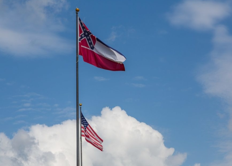 A US flag and flag of the State of Mississippi along High Street between the Mississippi State Capitol, Supreme Court, and Walter Sillers State Office Building in Jackson, Mississippi.