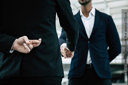 Businessman or politician cross finger, hiding behind his back during he get handshake to another person, businessman. Businessman pretend to be good person, he is liar. White collar worker is fraud