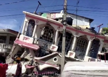 A view of a collapsed building following an earthquake, in Les Cayes, Haiti, in this still image taken from a video obtained by Reuters on August 14, 2021.  REUTERS TV via REUTERS THIS IMAGE HAS BEEN SUPPLIED BY A THIRD PARTY. MANDATORY CREDIT.